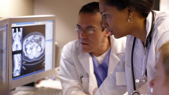 Two doctors looking at medical image on computer